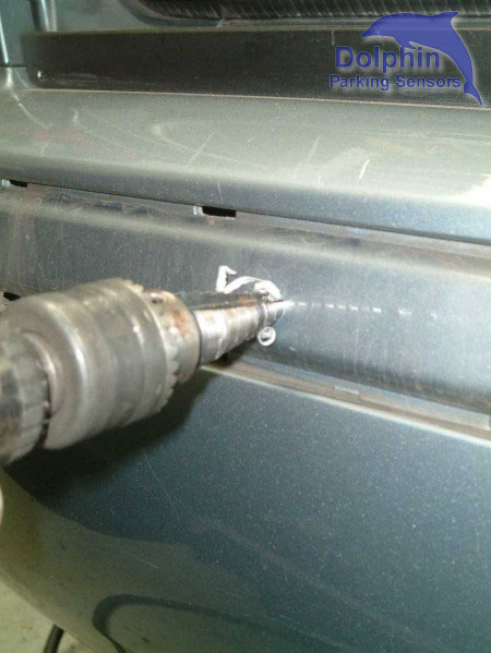 Use Guide hole to drill through bumper
