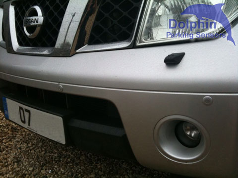Bumper above lights and grill