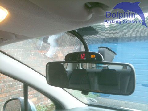 Display mounted on rear view mirror